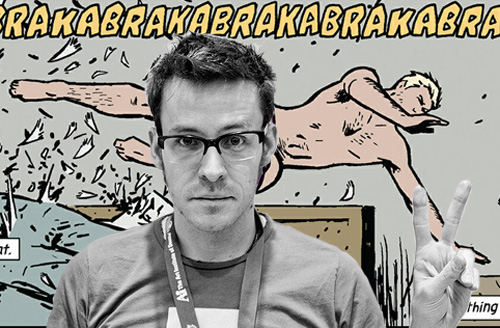 Author Matt Fraction in front of one of the more famous panels from the series, involving a certain almost-naked Avenger.