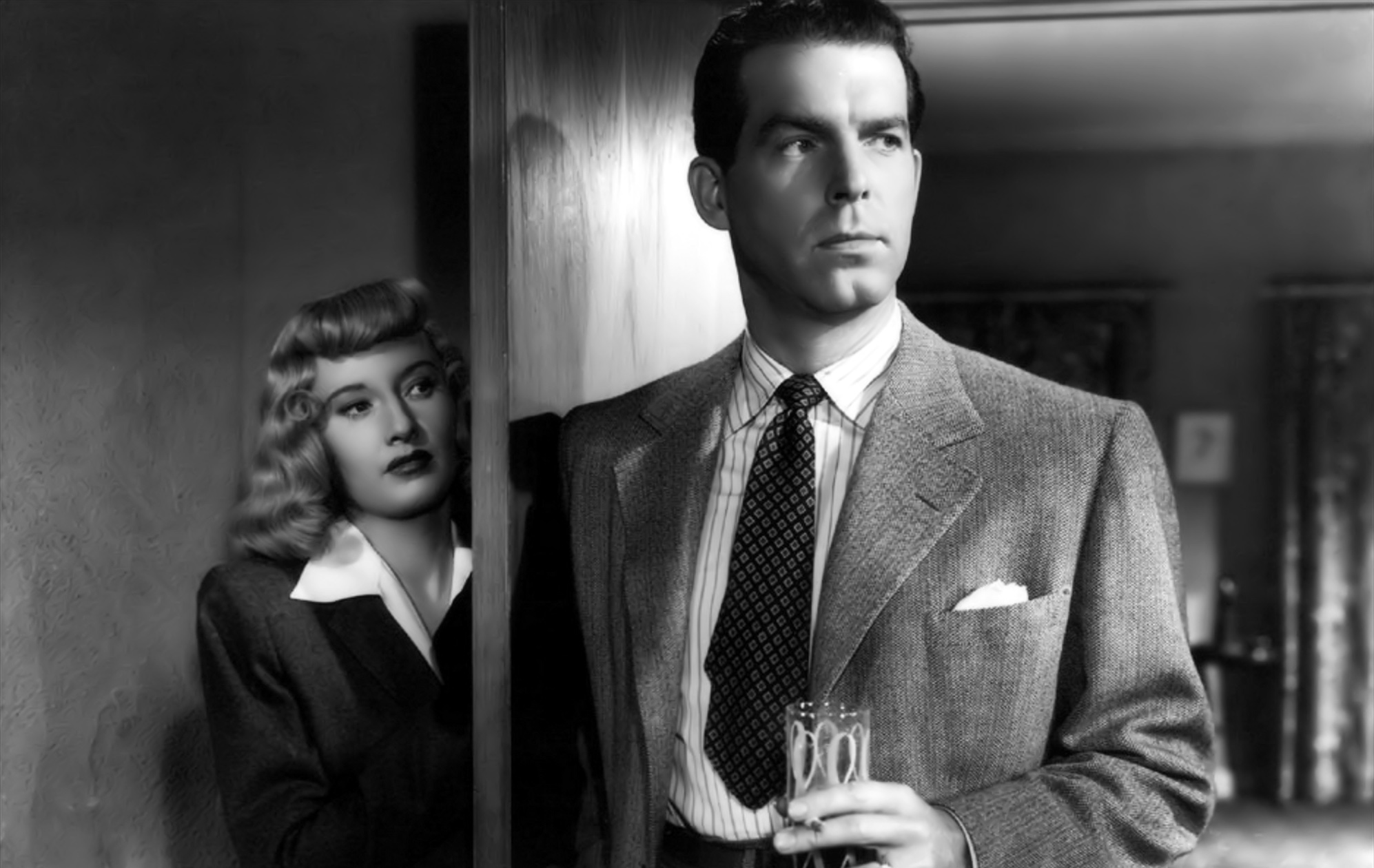 Barbara Stanwyck as Mrs. Phyllis Dietrichson and Fred MacMurray as Walter Neff in  Double Indemnity