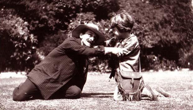 Barrie with Michael Llewelyn Davies dressed as Peter Pan