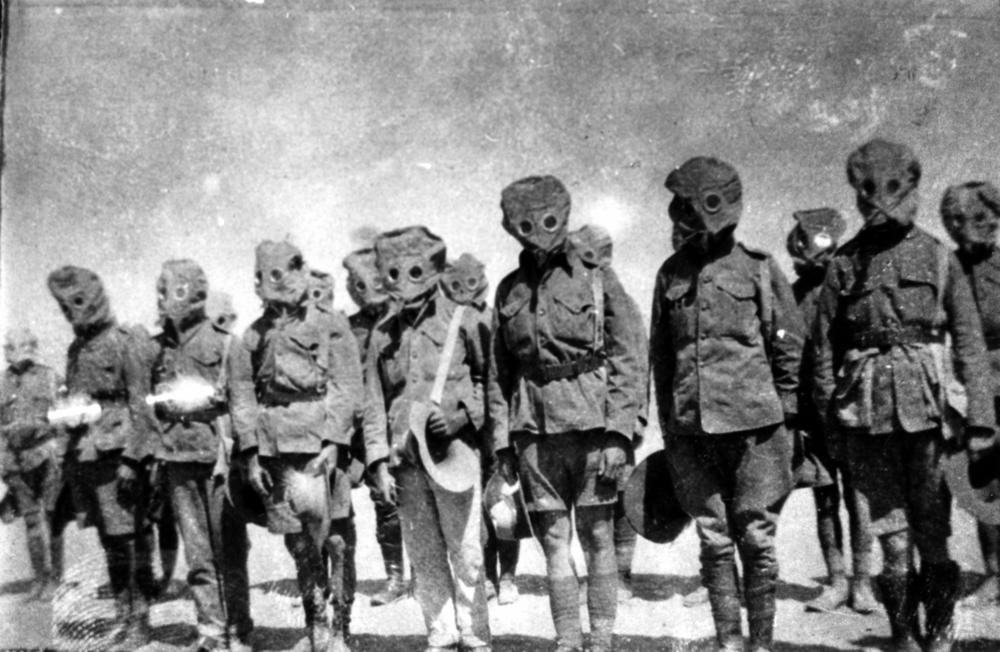 Soldiers in gas masks during World War I (via  State Library Queensland )