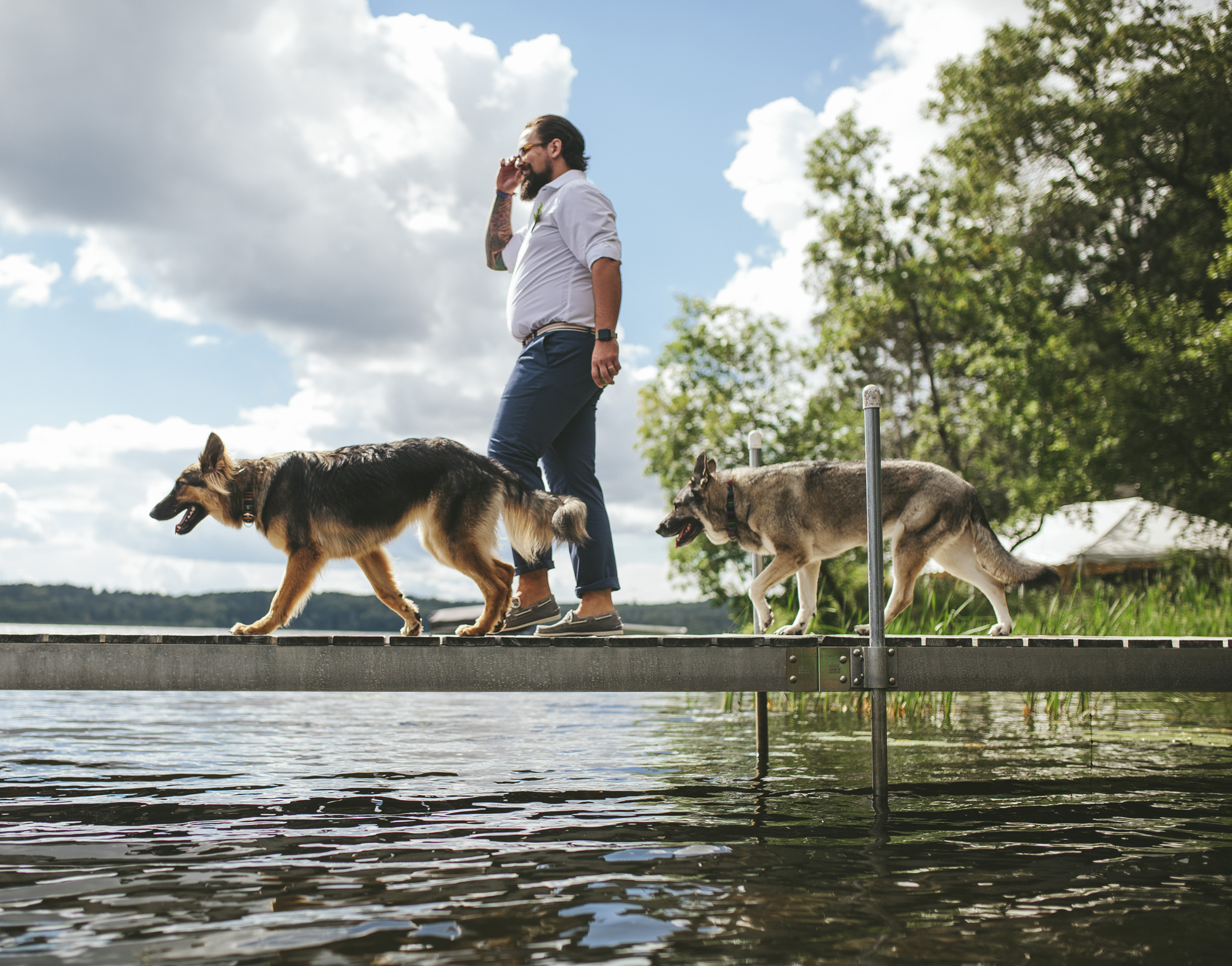 Brandon werth northern minnesota wedding photographer lake ceremony outdoors dogs walking down aisle