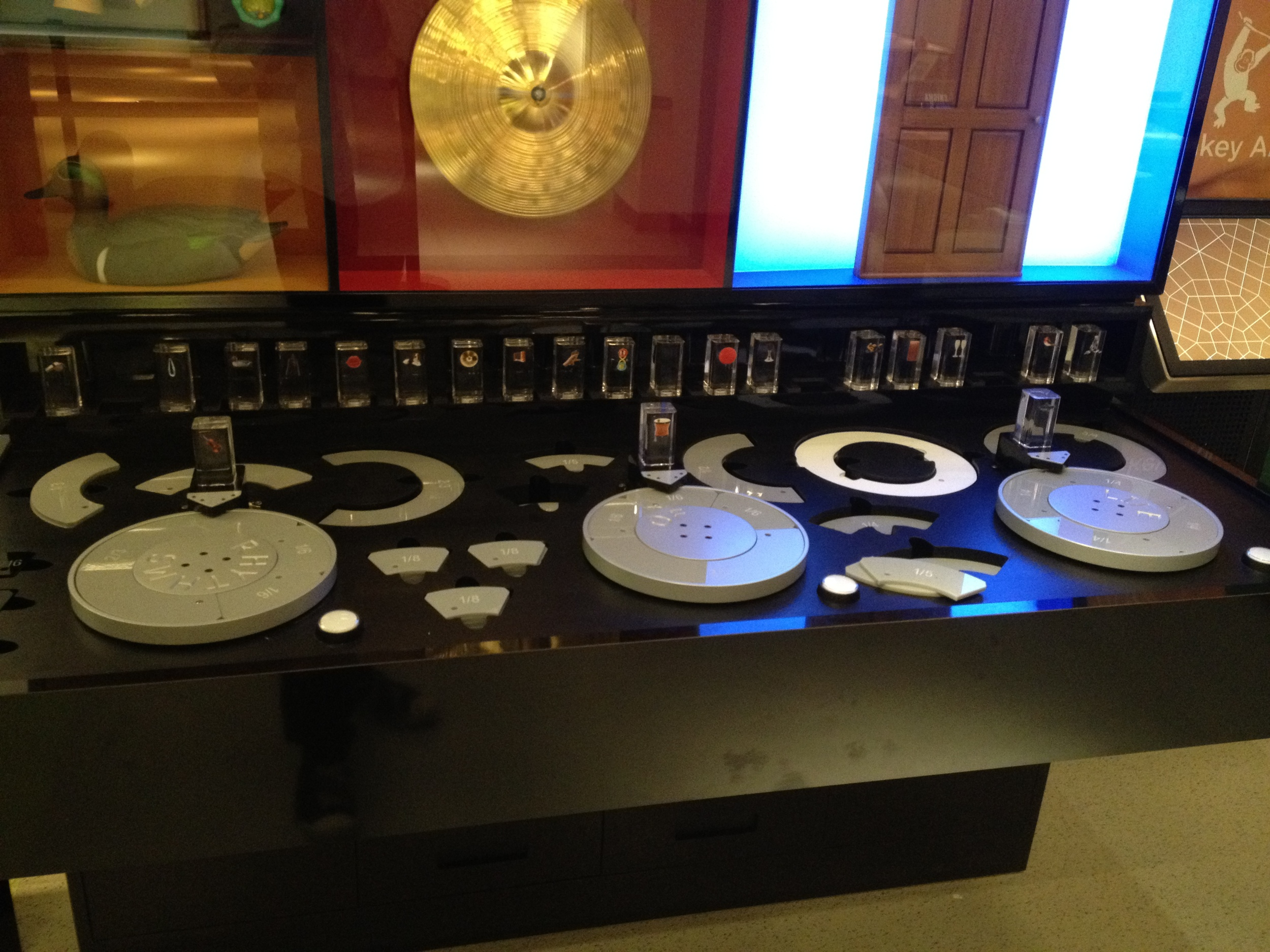 A neat music-making setup, each little block contains an RFID chip that actuates a different sound. The turntables rotate and trigger the sound with tempos matching the grey inserts (see next image)...