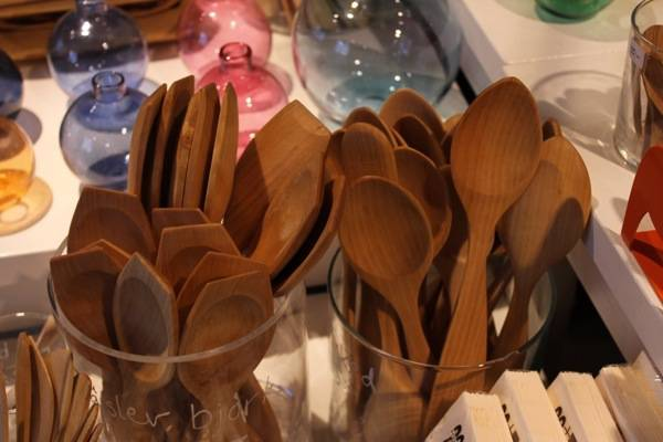 factory made production spoons, these are made in a town north of Stockholm. Folks want wooden spoons but the spooncarvers want to make one off's so the shop sells these as well.