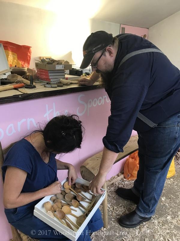 Barn and Jazmin looking at spoons