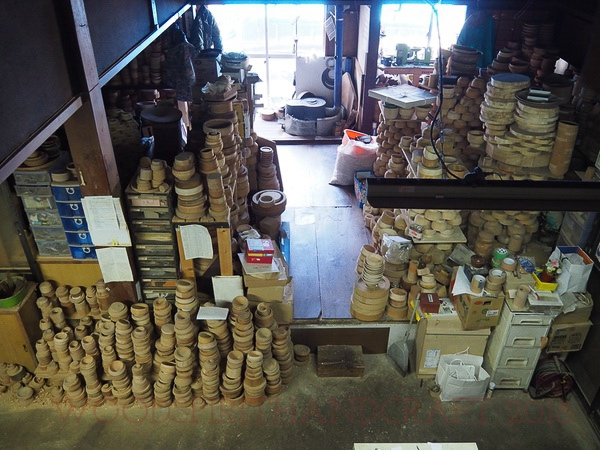 Takehito's woodturing workshop with all the bowl blanks waiting to be turned.