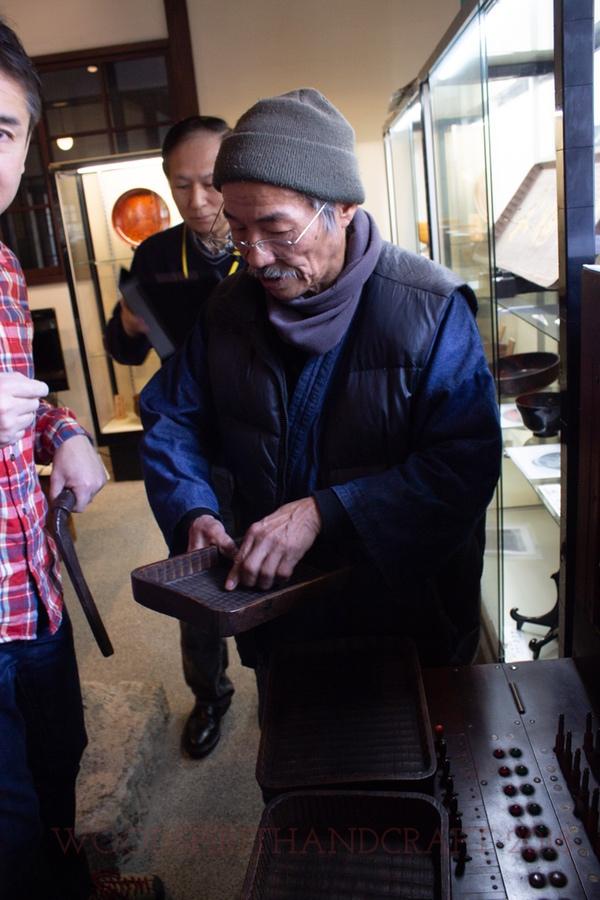 Shinichi and an antique tray.