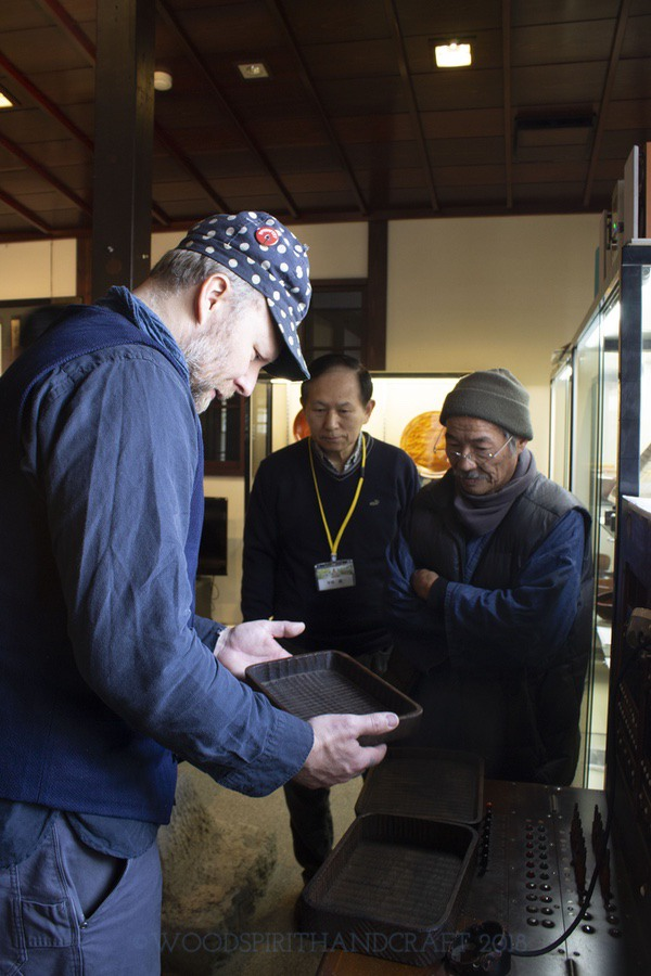 Shinichi-san showing me a few antique trays at a small museum in Yamanaka-onsen.