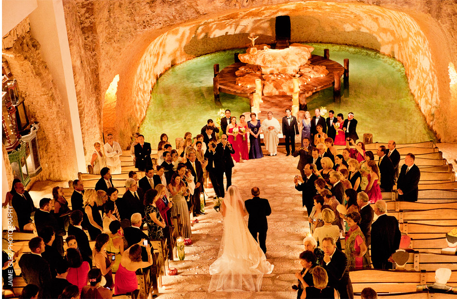Underground wedding ceremony at the magical Chapel of Guadalupe at Xcaret Park Playa del  Carmen Riviera Maya Mexico.