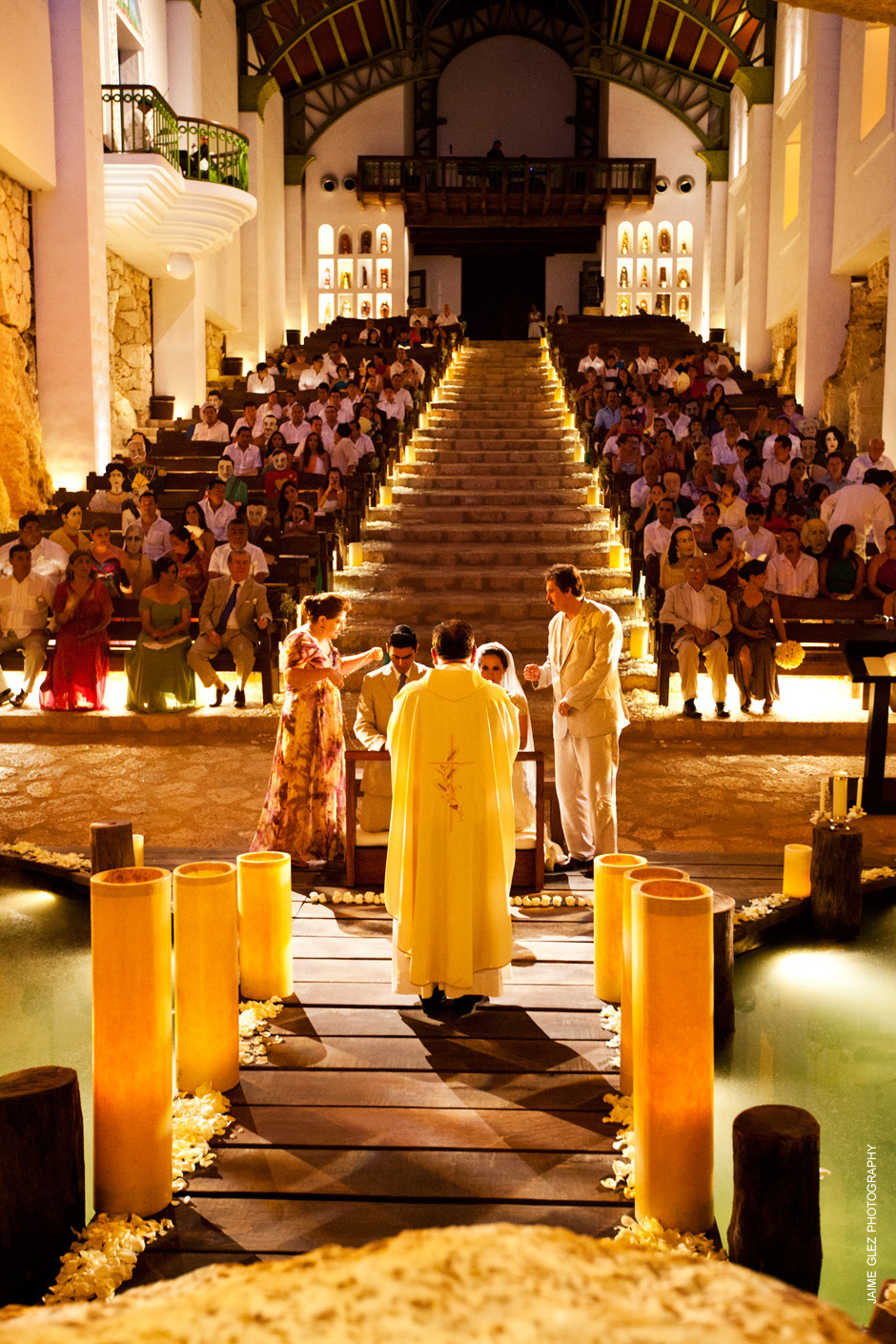 Back view of wedding ceremony in our Lady of Guadalupe Chapel in Xcaret Park, Mexico.