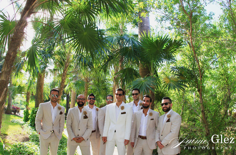 Groom and groomsmen posing in the nature of Riviera Maya..