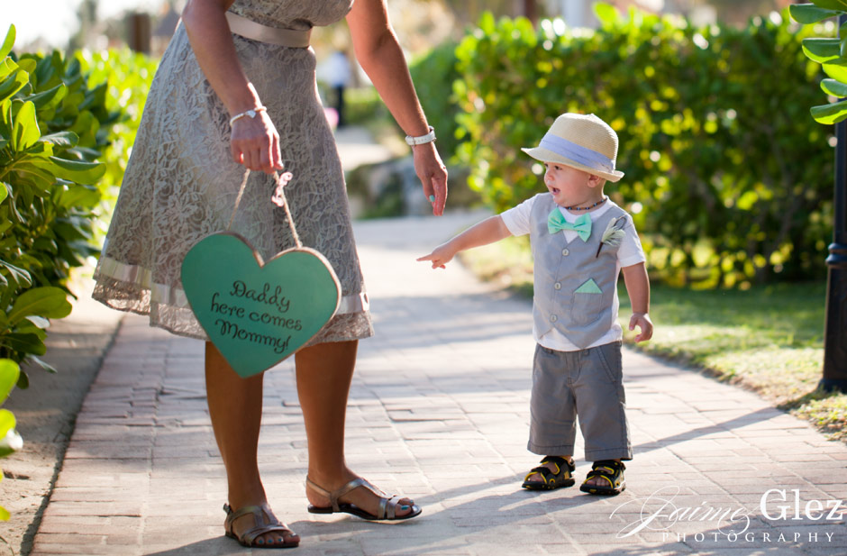 The cute little son of the bride and groom wearing an incredible outfit!