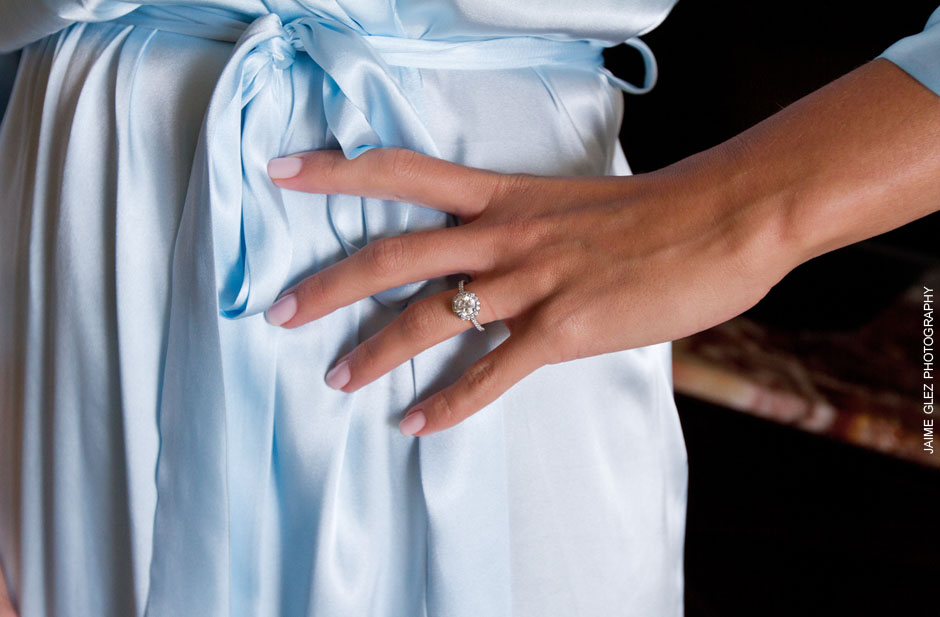 Bride wearing a lovely vintage engagement ring.