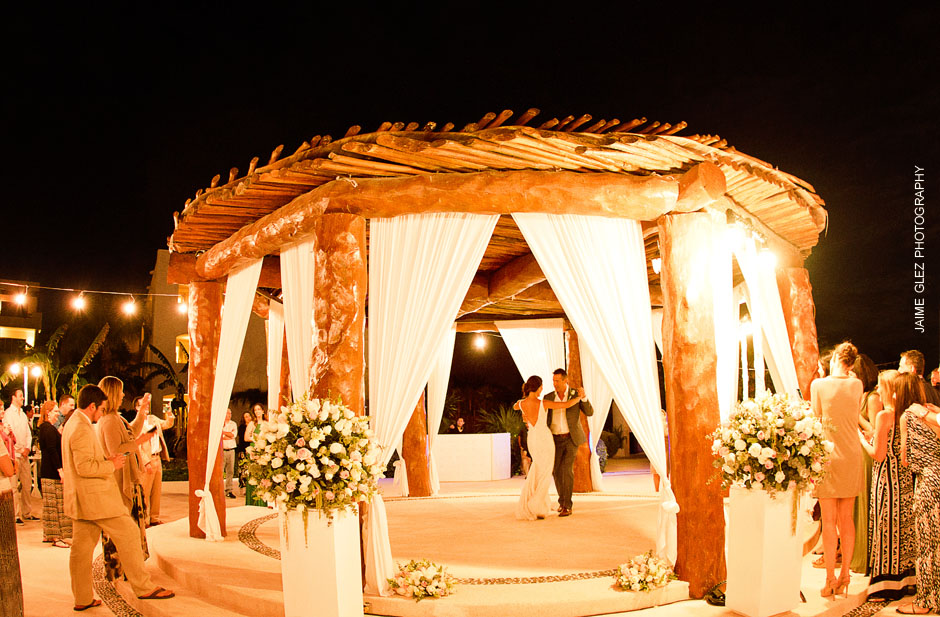 Newlywed's first dance under a romantic gazebo.
