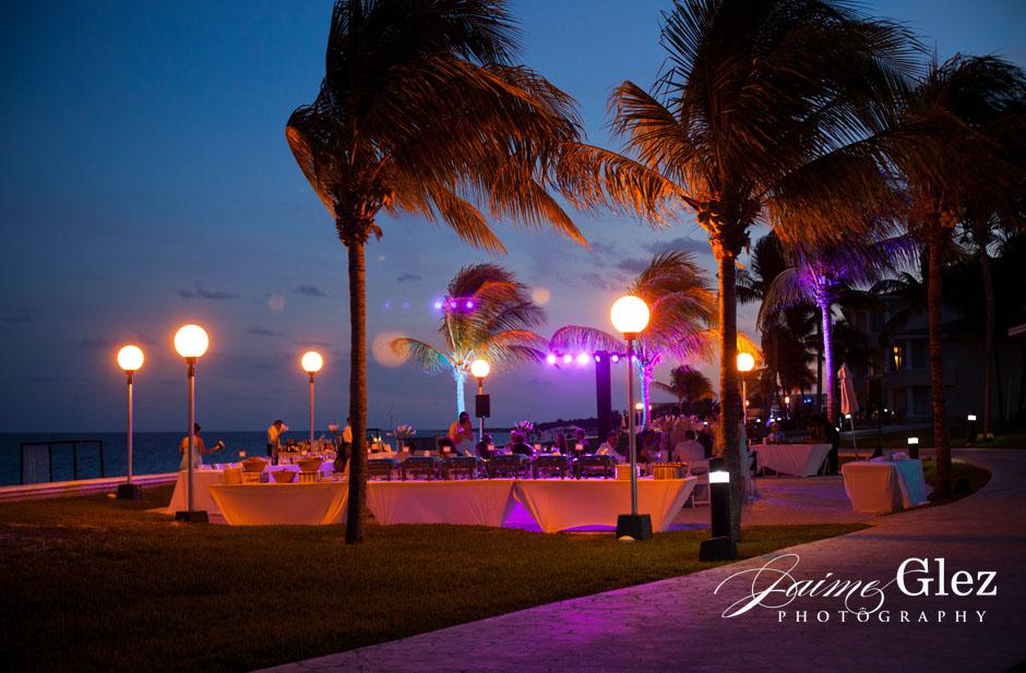 Outdoor wedding reception with ocean view.