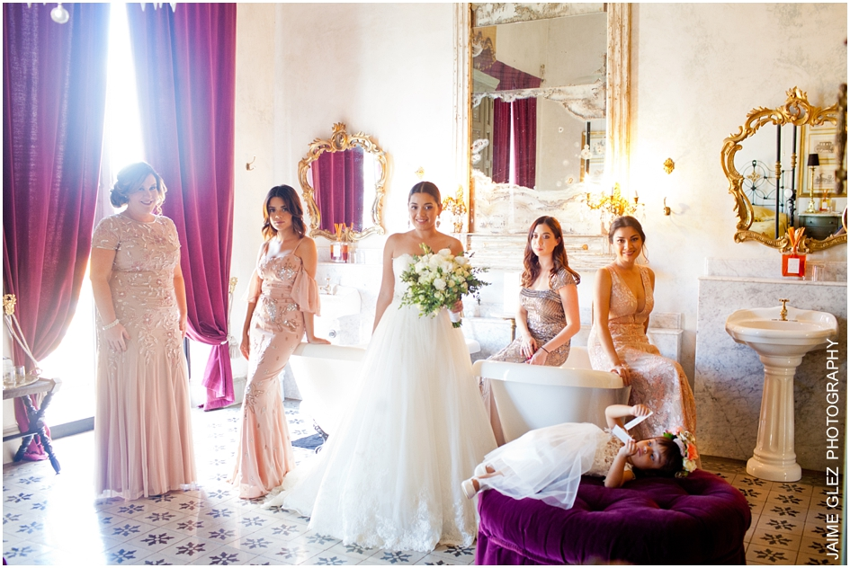 Bride and her beautiful bridesmaids in pink.