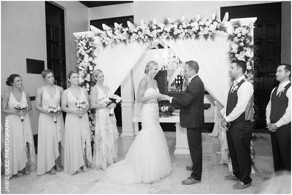 Sweet moment of sharing vows and rings.