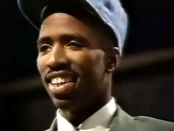 """Fun Fact: In 1987, Kenny """"The Jet"""" Smith was the first guy to put on the team hat on stage when he was drafted by the Sacramento Kings."""
