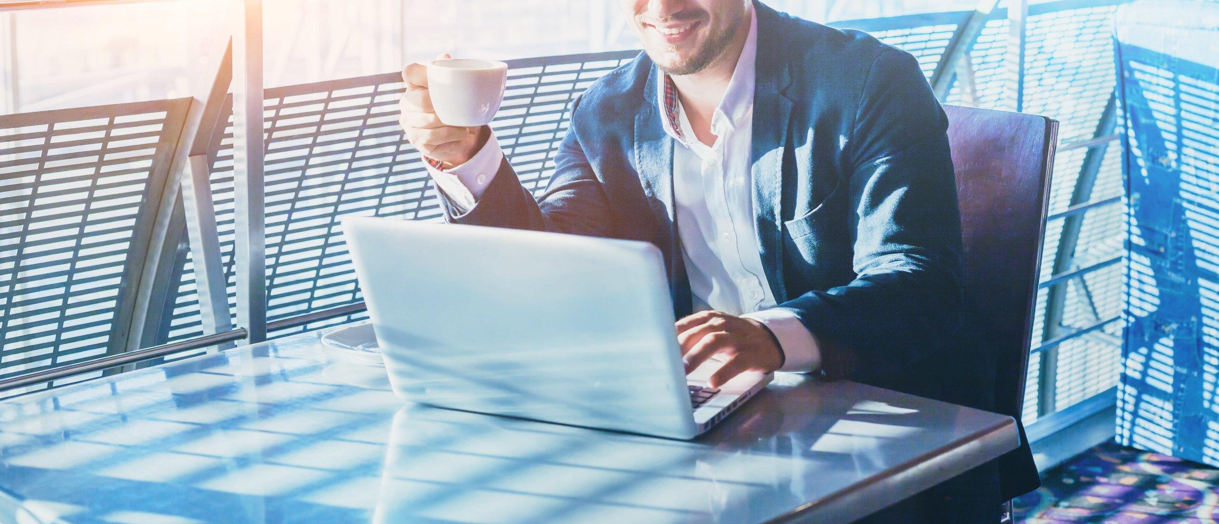 Business man on laptop video conference-min.jpg