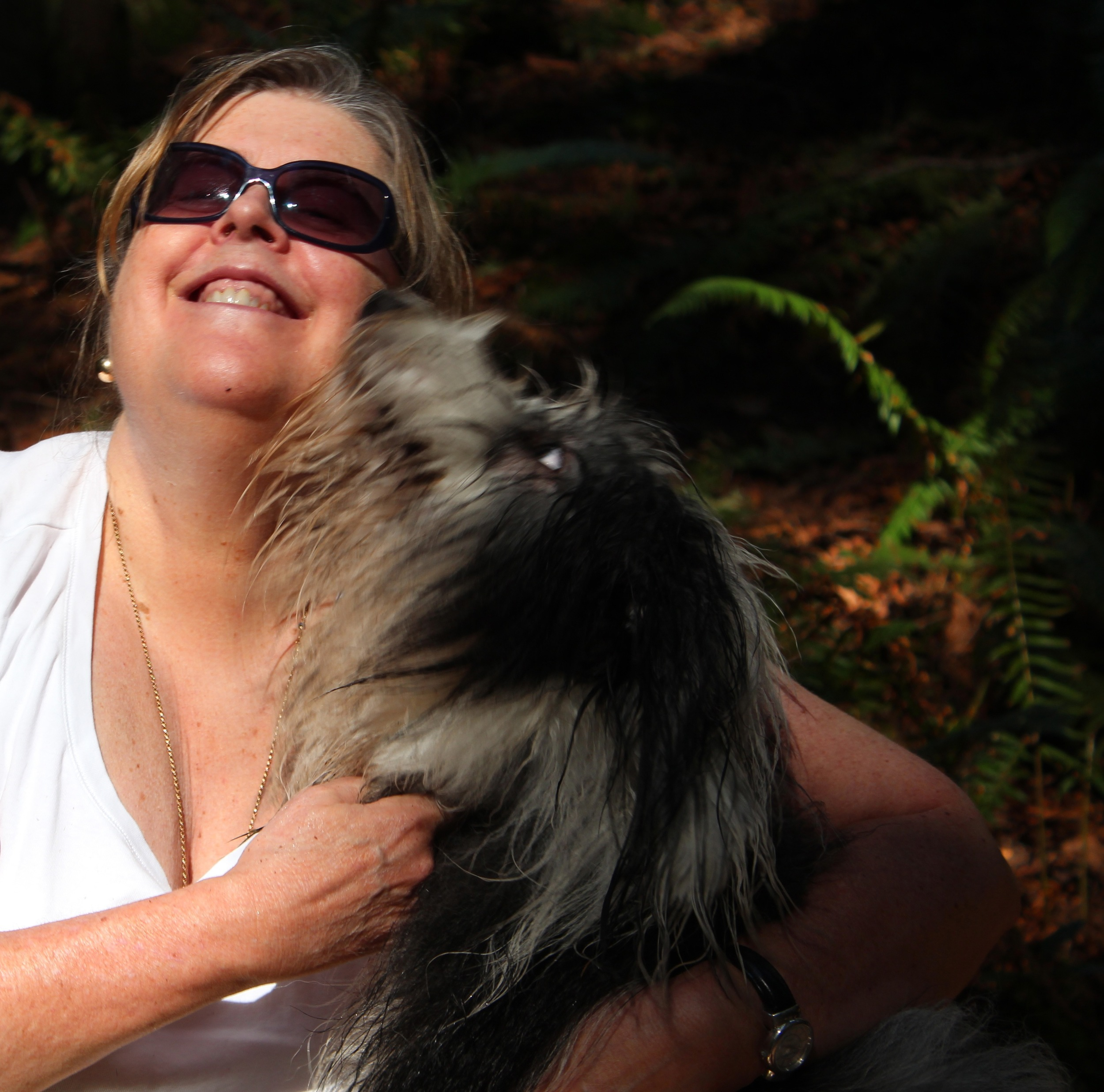 Lily is actually black and white, but not so after a day in the forest romping in water and mud! This is a picture of a happy woman and her dog, yes, but more, it's a picture of love. Of the generosity and joy of it.