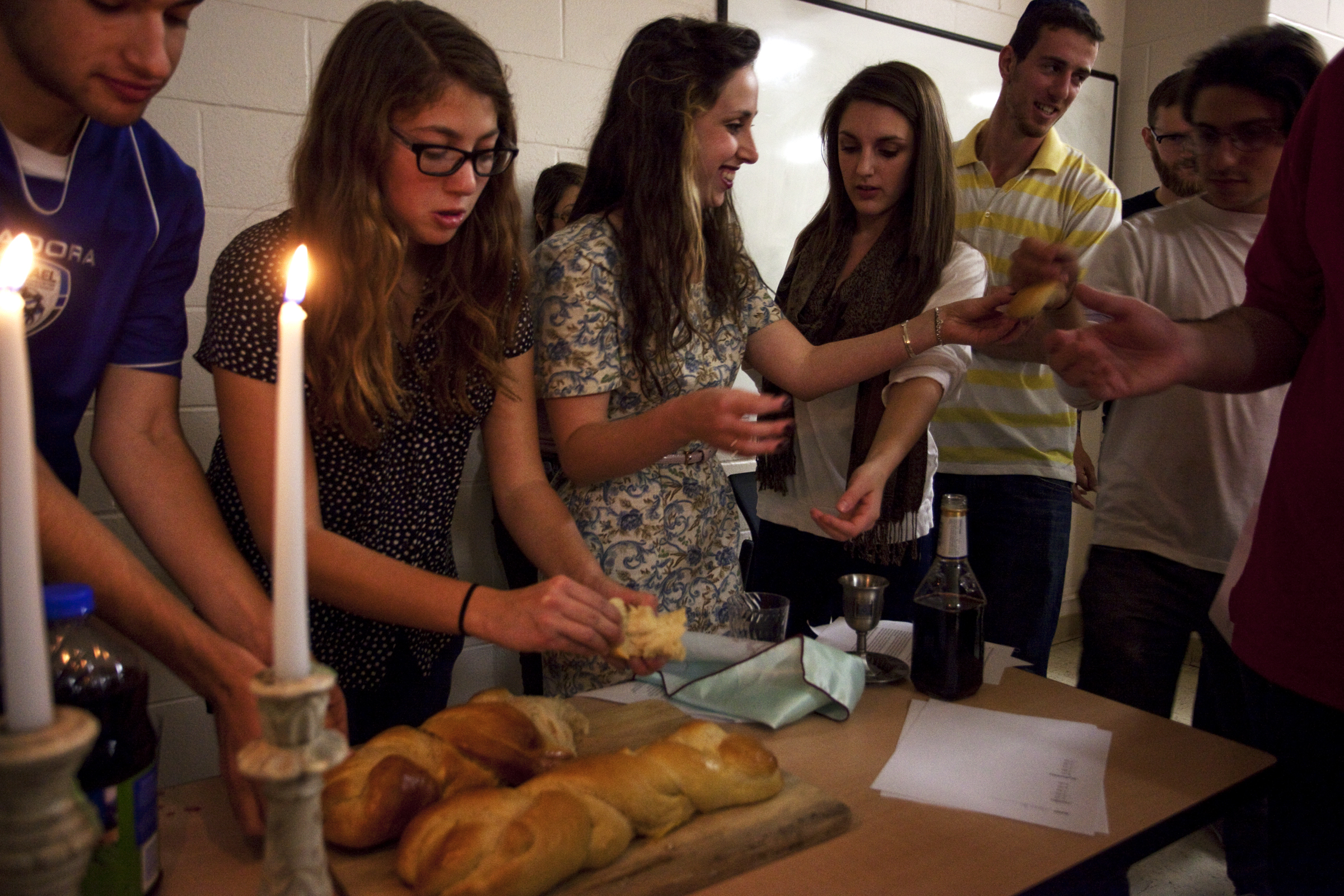 Tracy Jo Ingram, a Louisville, Ky senior, passes Challah, a traditional Jewish bread, around during the first Jewish Student Union Shabbat dinner on Friday, November 9,2012. Shabbat is the seventh day of the Jewish week, traditionally meant for rest. Western's Jewish Student is in its first year on campus.