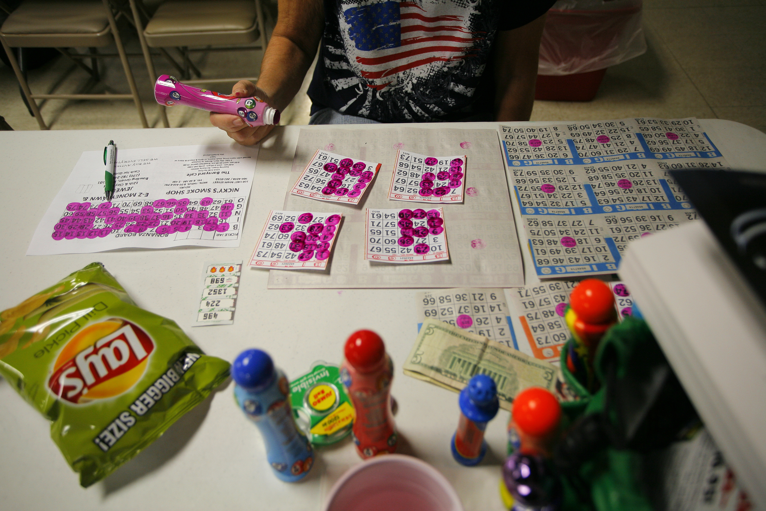 """Barbara Daugherty, of Morgantown, Ky., prepares to play bingo at the VFW in Bowling Green, Ky. Daugherty plays bingo two times a week, """"It's relaxing,"""" she said about playing. Daugherty won $1,500 in one game when she and her husband were stationed in Japan during his service in the Air Force."""