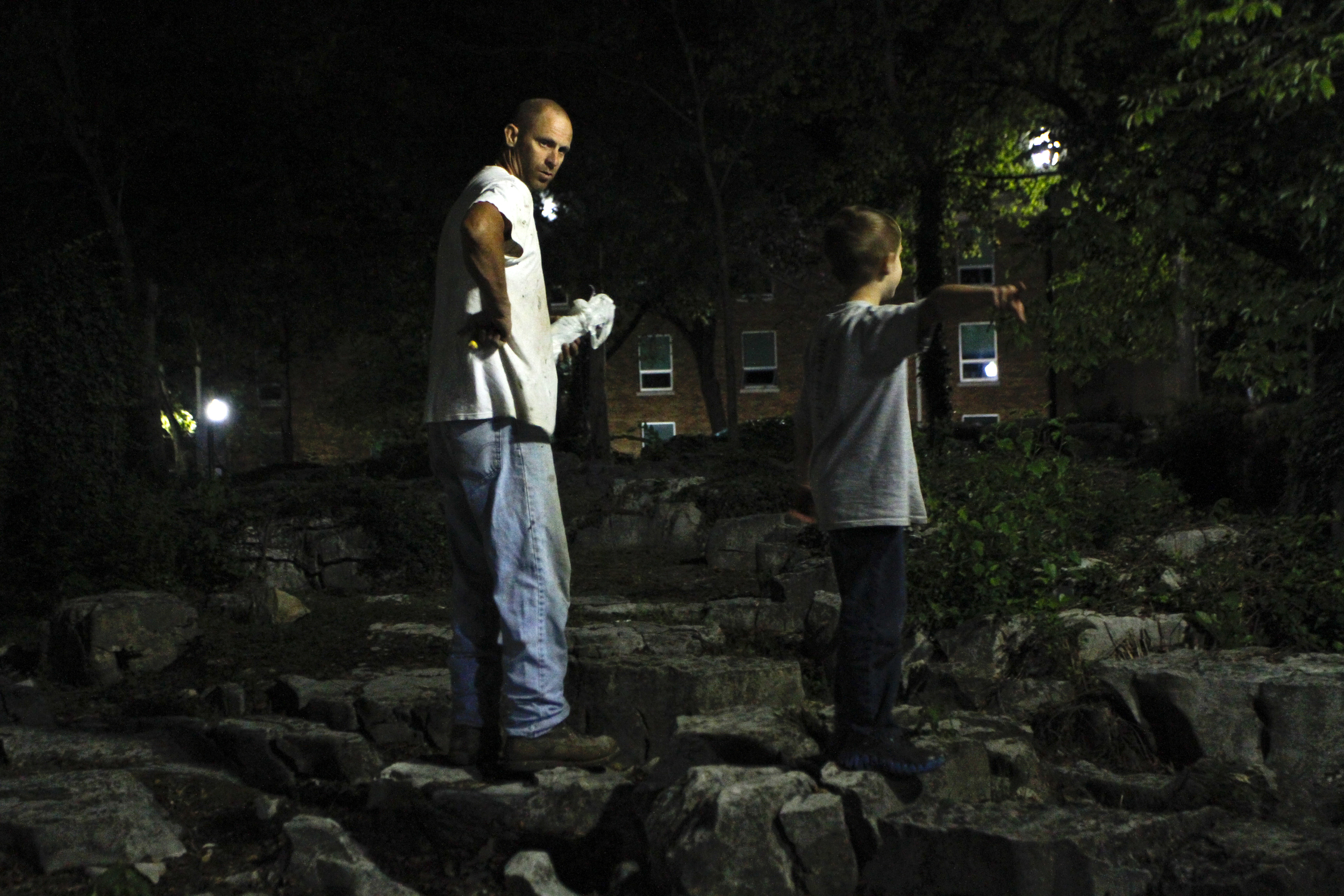 """John Stucy, left, takes his son, Elijah Stucy, 6, on an evening walk around Westerns campus. Stucy shared the locations Civil War history with his son during their walk. """"He's the best thing I've got,"""" Stucy said about his son."""