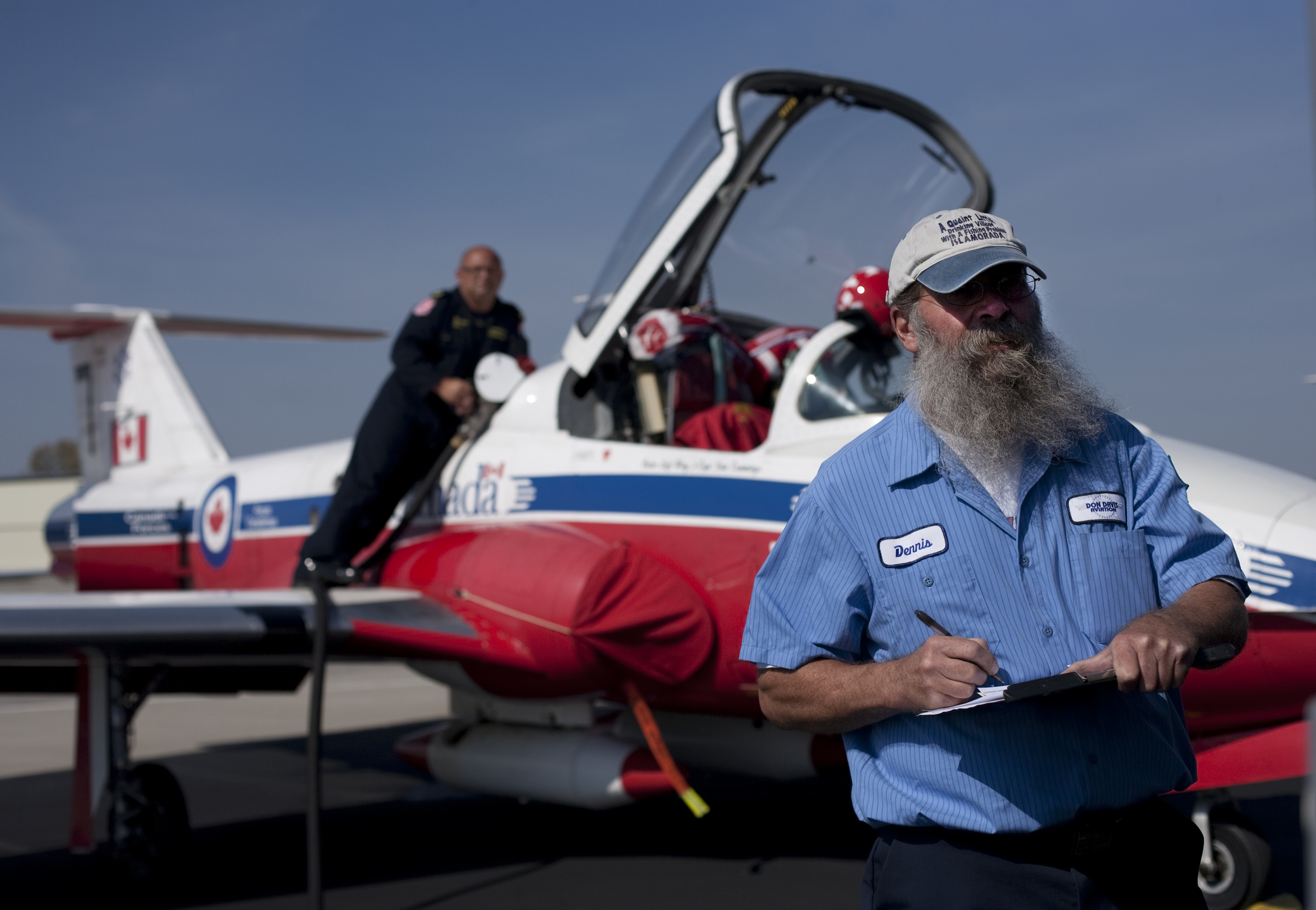 Dennis Montgomery, of Evansville, Ind., monitors fuel gauges as he refuels a member of the Canadian Snow Birds' aircraft. Montgomery has been working at the Henderson Kentucky Regional Airport for four months. The summer drought cut into his lawn care business profits and he had to reenter the job market.