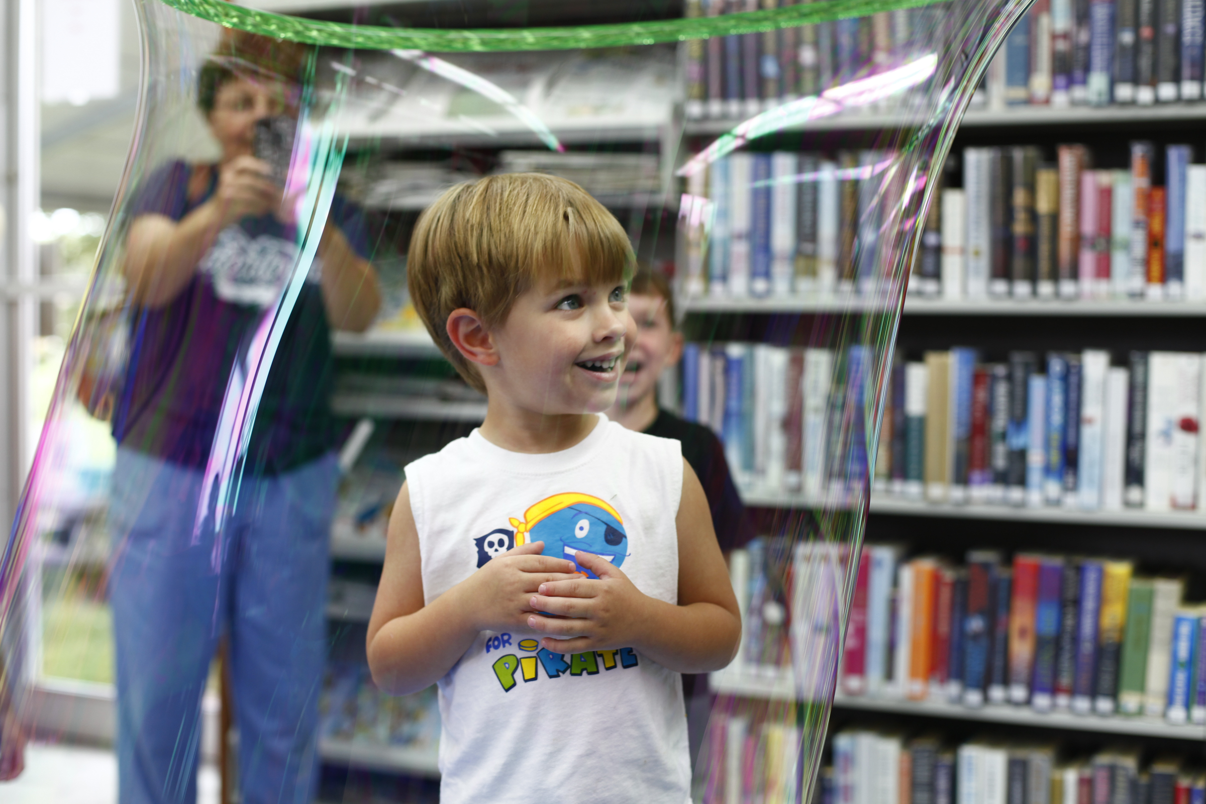 Callen Henshaw, 3 of Morganfield, Ky., is placed inside of a large bubble that was formed with a toy hoop.