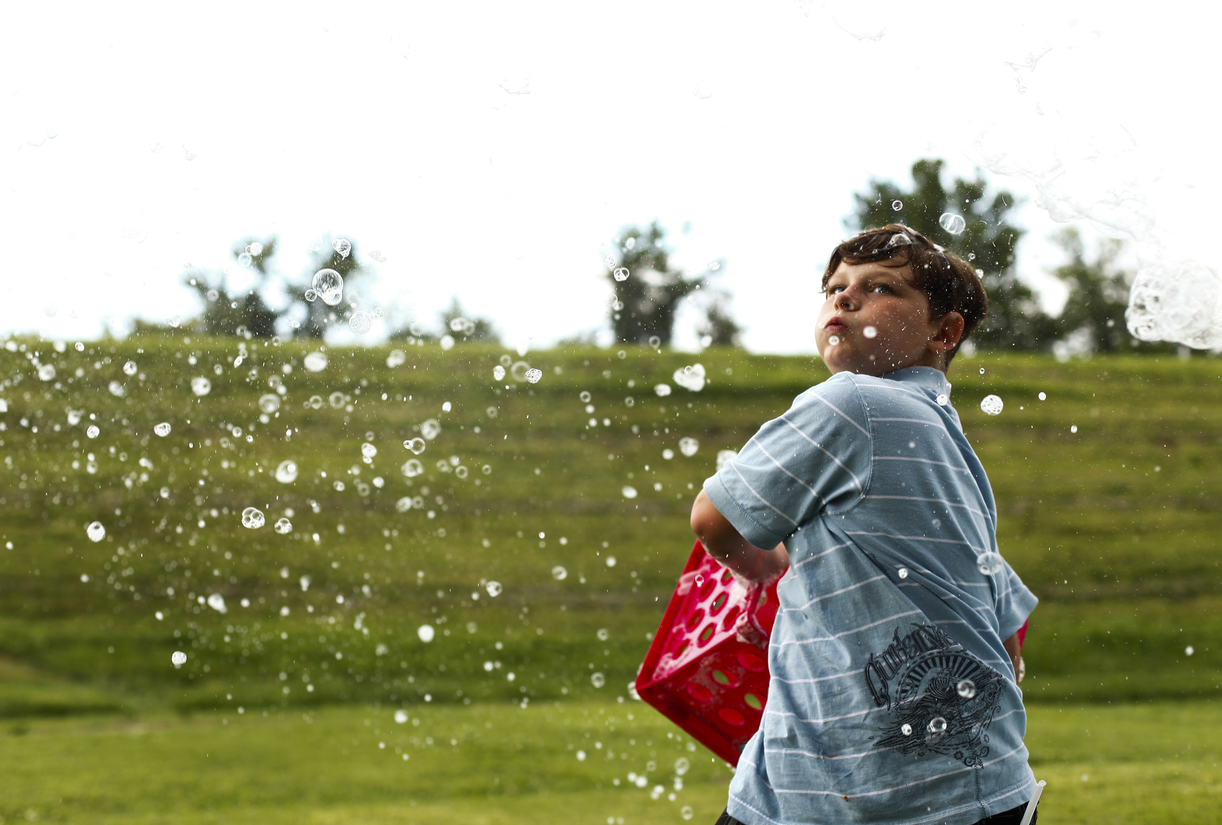 JT Powell, 10 of Uniontown, Ky., forms bubbles with a crate.