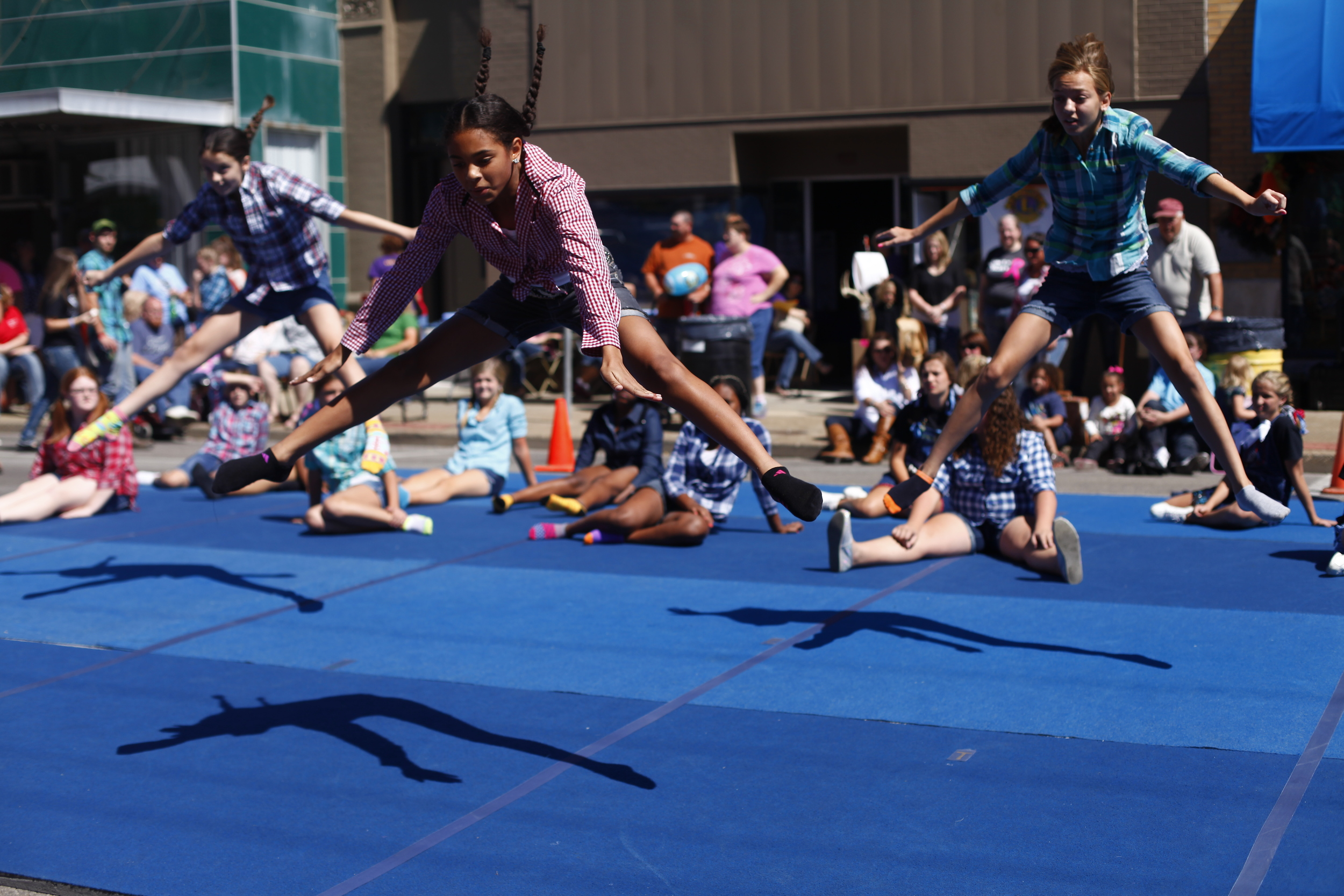Members of the Union County High School Dance Team perform toe touches during a jump off on Saturday.
