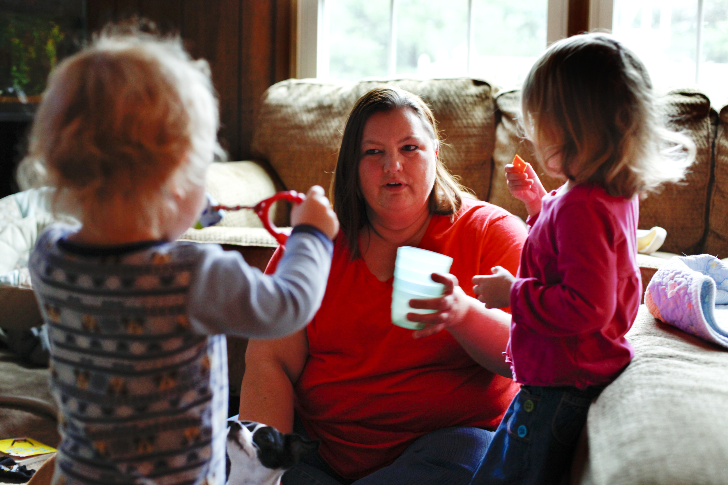 Debbie Lance offers a snack to one of the four children she and her husband are currently fostering. The Lance's have been foster parents since 2008 and have thirteen children, four foster children and nine grandchildren.