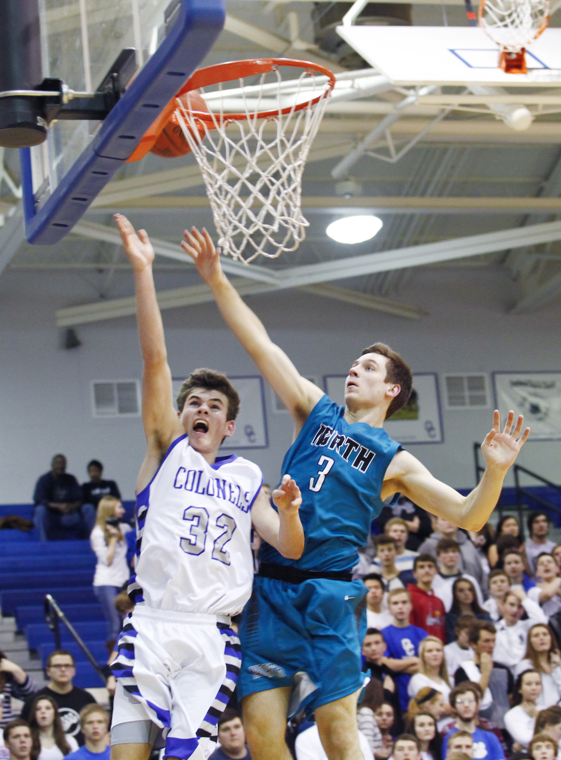 Oldham County sophomore Griffin McLarty goes for a layup against North guard Trevor Burton during their January 30th 62-48 win in Buckner.