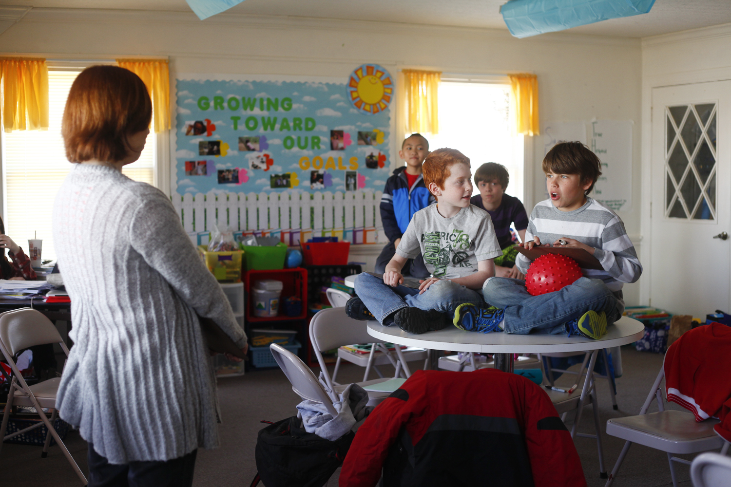 Caleb Von Busch, striped shirt, answers a math question during an end of the day game at Jubilee Academy.