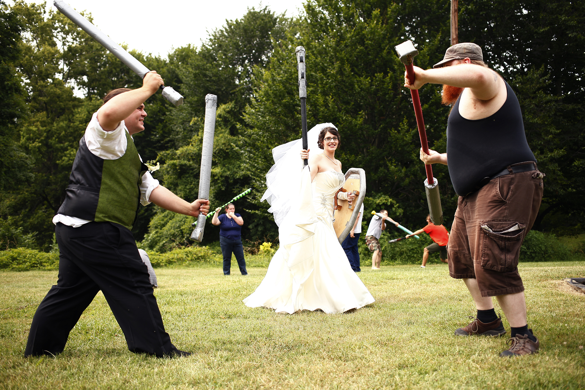 Aaron Mackison and Bekah Calabro stopped by a LARPing Meet and Beat after their nuptials. Live Action Role Playing is a fantasy game played in many different ways across the world. A Meet and Beat was held in Cherokee Park to get new players familiar with the game and weapons, or boffers, used to play.