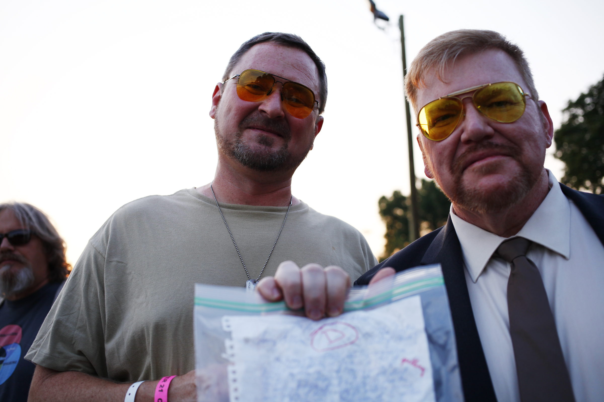 Bryan Beisner, of Louisville, and Ed Fulop of North Palm Beach, Fla., pose with Larry's Homework while dressed as Walter Sobchak.