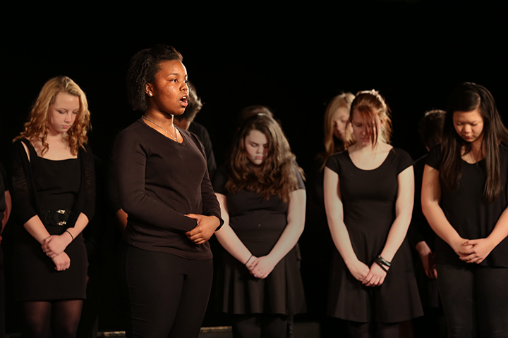 Anastasia Chapman sings with the Noe Middle School Chorus as part of the Anne Frank: Bearing Witness project. The project introduced middle school students to the Diary of Anne Frank and asked them to reflect and respond to what they read using performance art.