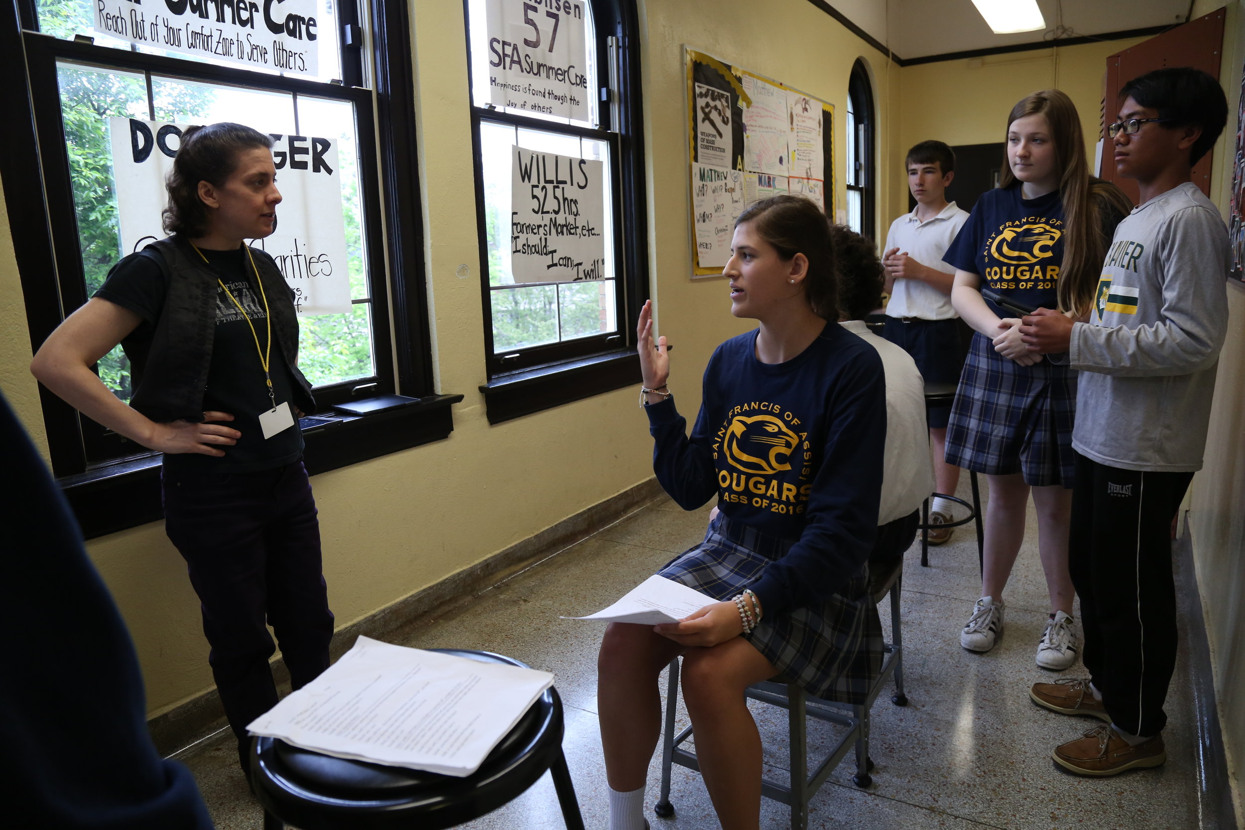 Teaching artist Talleri McRae gives pointers to students at St. Francis of Assisi after they performed an original skit about people affected by the Holocaust.