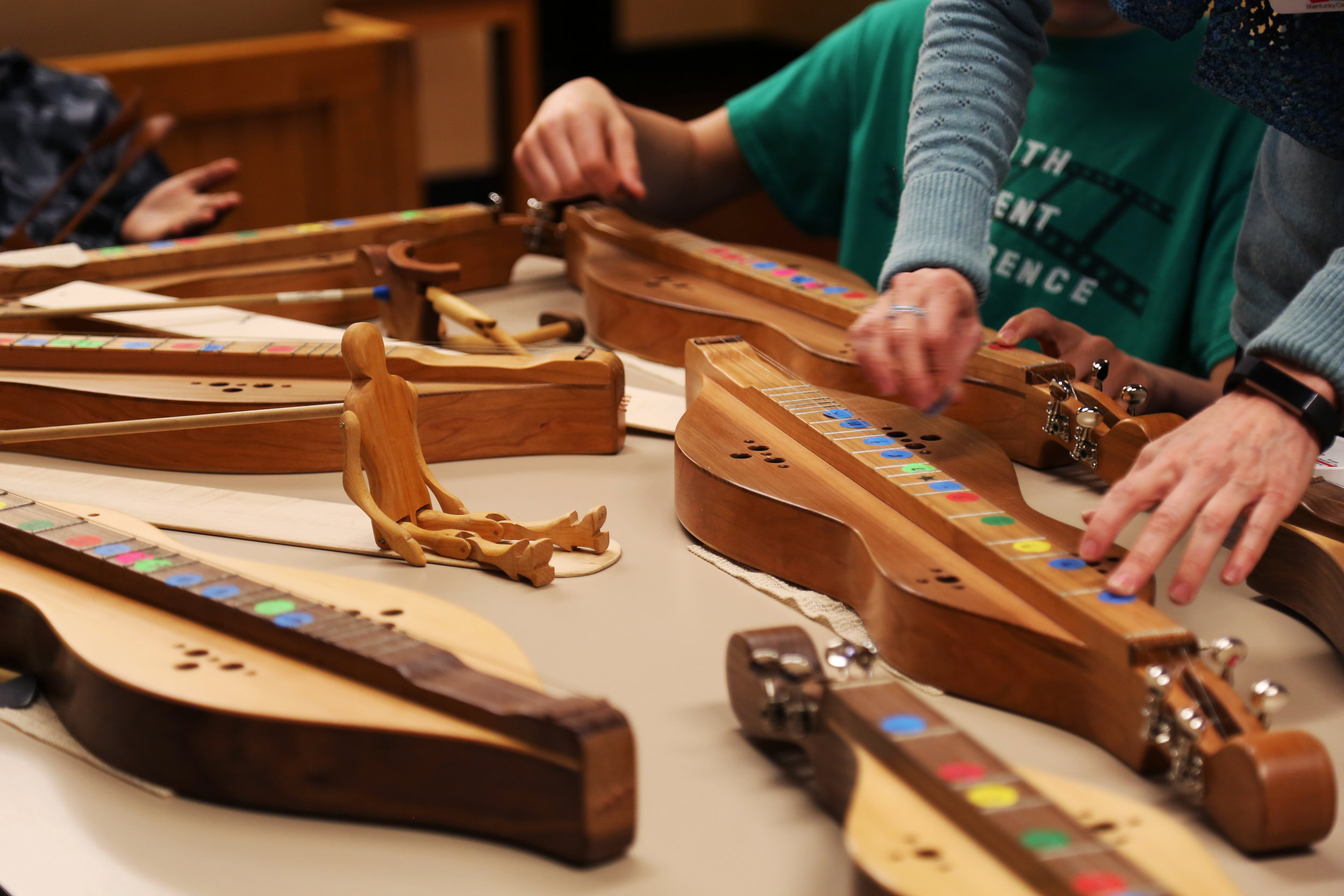 Children in crisis learn to play the Mountain Dulcimer (the Kentucky state instrument) with AIH artist Lorinda Jones. Here's to finding creativity during a crisis!  For a video on our work with youth, follow this link: https://youtu.be/cWH-I_yX-UA