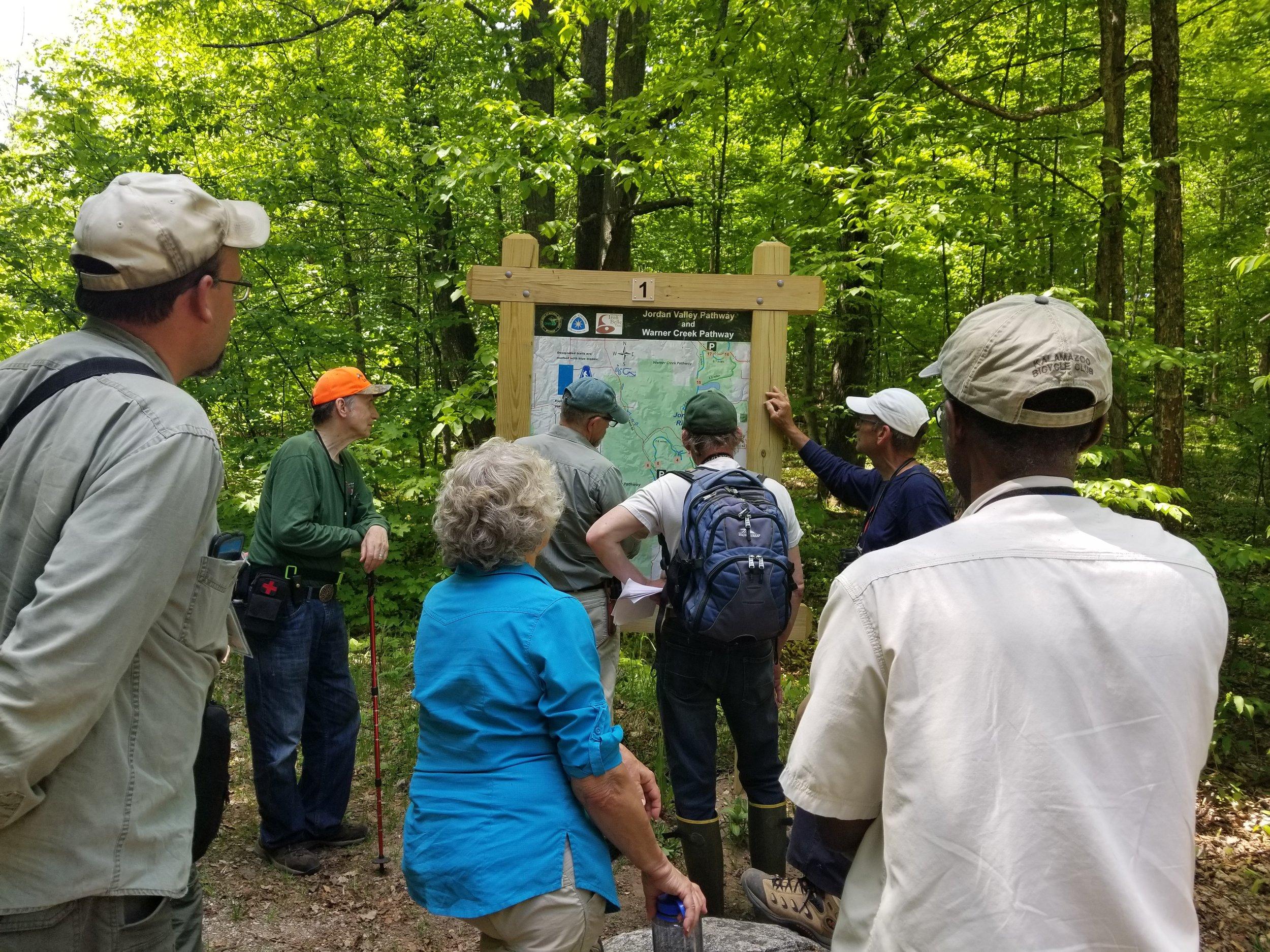Jordan R (53) Glenn VandeWater explains Warner Creek Pathway map.jpg