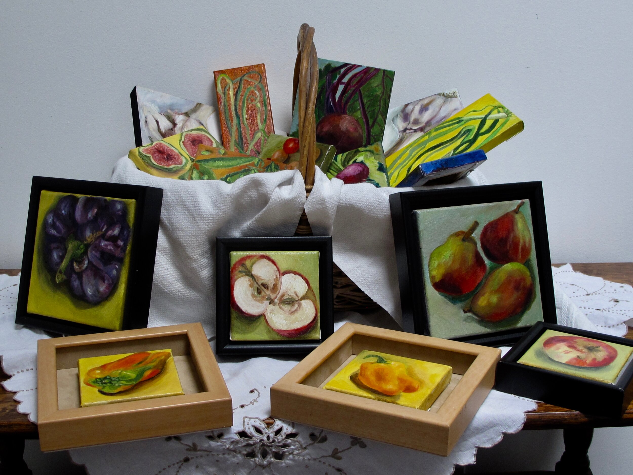 A basket Full ! A variety of mini oil paintings of fruits and veggies from Gabriola's Framer's market ranging in price from $50- $ 120 . These make nice gifts or addition to a kitchen decor and sell quickly. Contact me if you want to see them in detail.