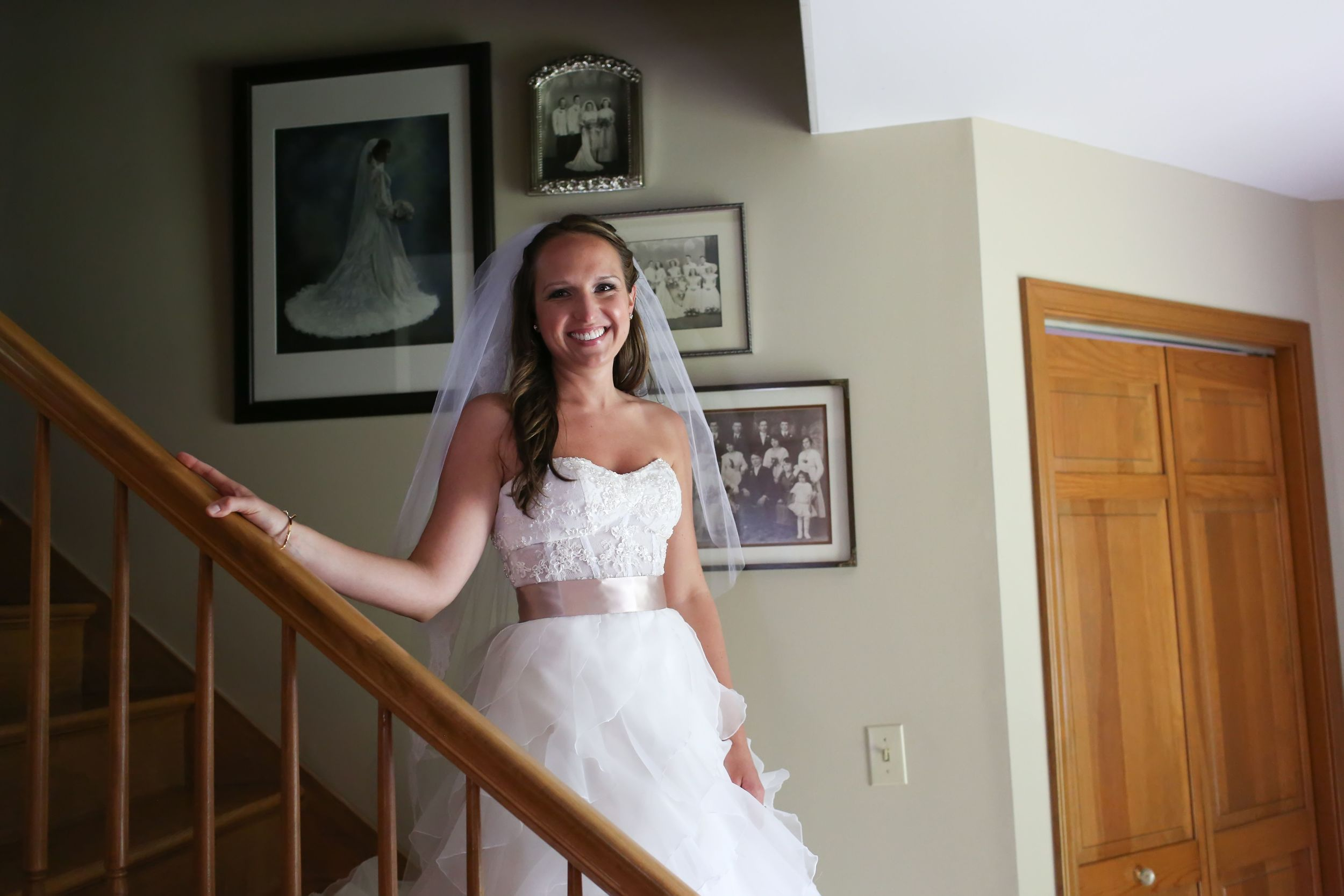 LOVED this moment, love the photos of all of the weddings from the past generations in the background.