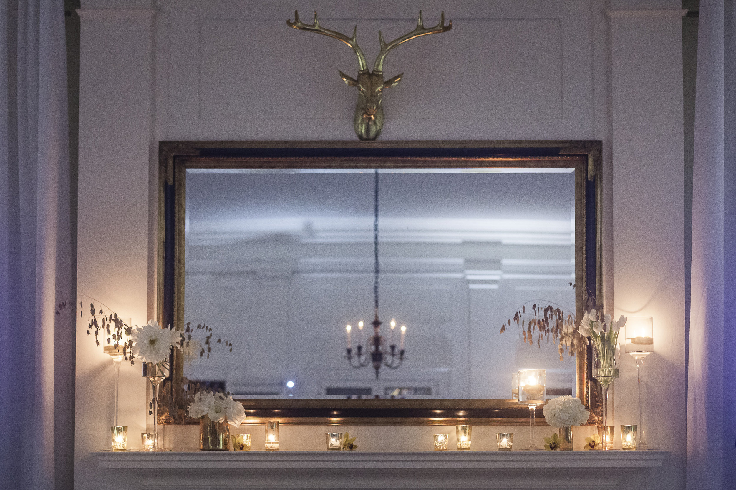 I am in love with this fireplace display by  Carrie Wilcox Floral Design  - it is simple, beautiful and very cool.