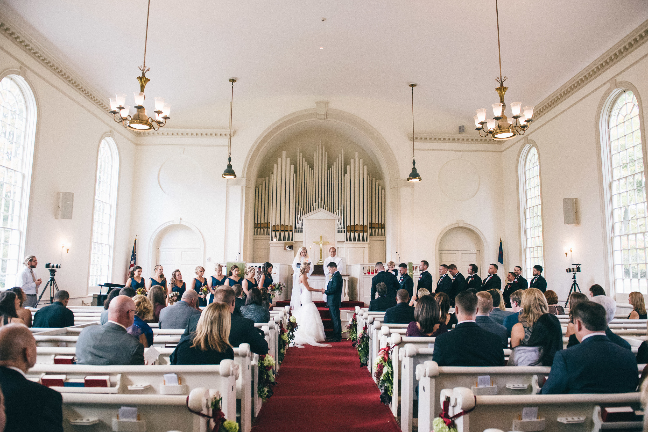 CT Wedding Inn at Longshore Amy Champagne Events Ceremony Church Aisle