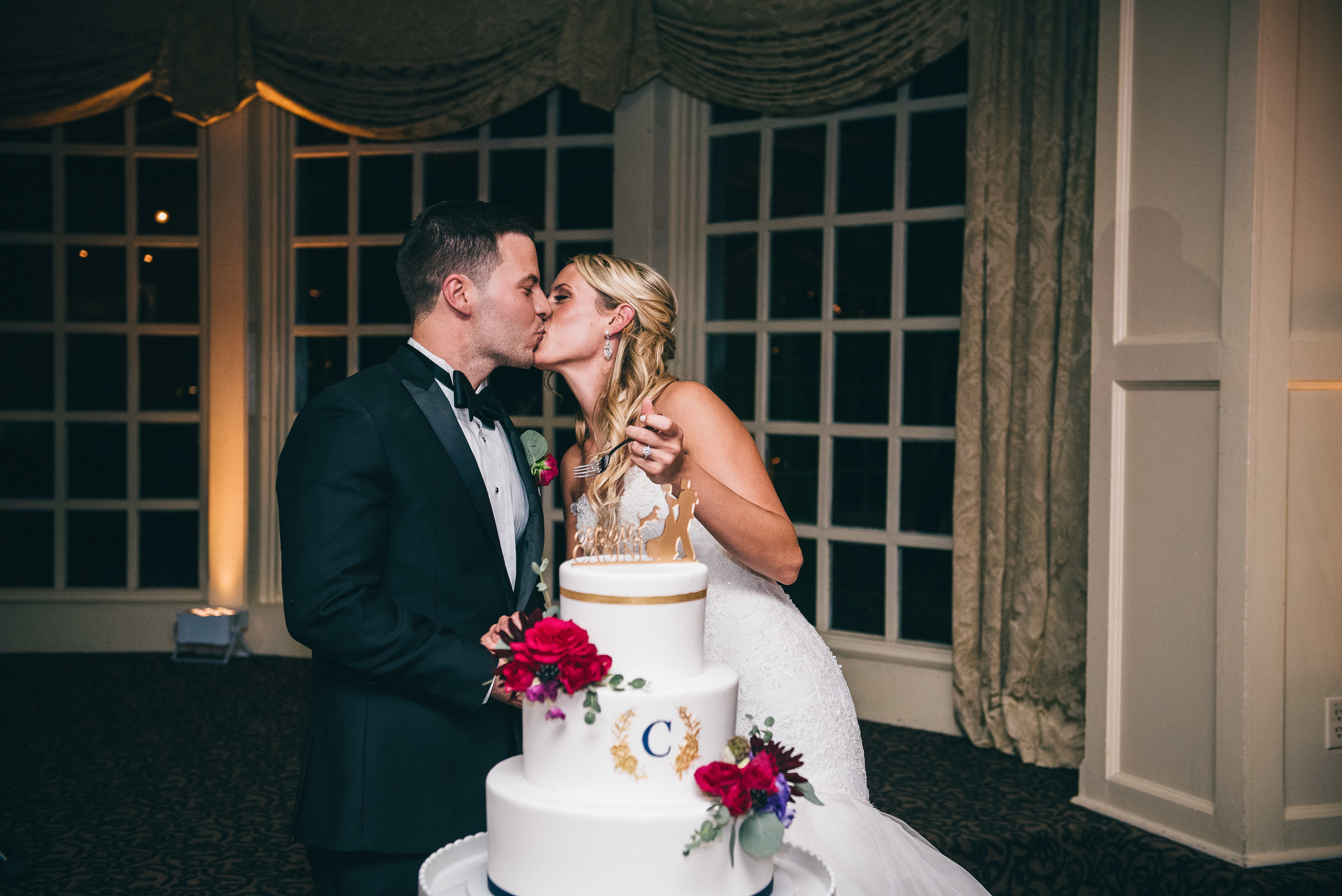 CT Wedding Inn at Longshore Amy Champagne Events Reception at Inn at Longshore Cake Cutting Kiss