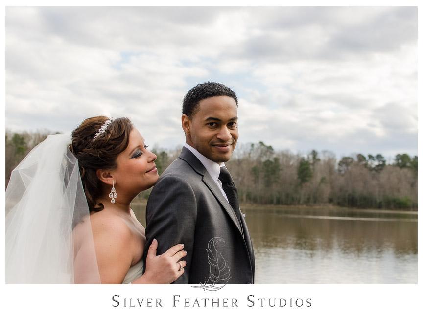 Bride & groom on pier at Bass Lake - Holly Springs Wedding Photographer