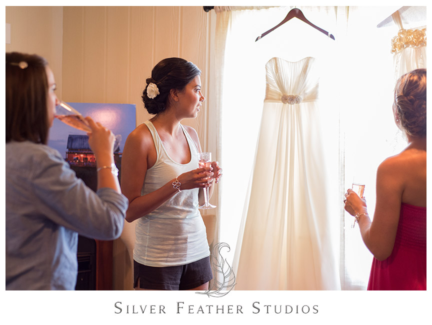 Bride waits at Starlight Meadow to get in her wedding dress. © Silver Feather Studios
