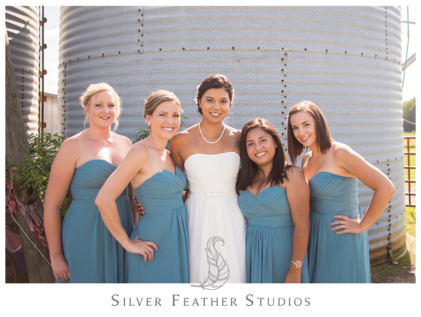 Bridesmaid look fabulous in blue at Starlight Meadow in Burlington.   © Silver Feather Studios, Burlington, NC Wedding Photography