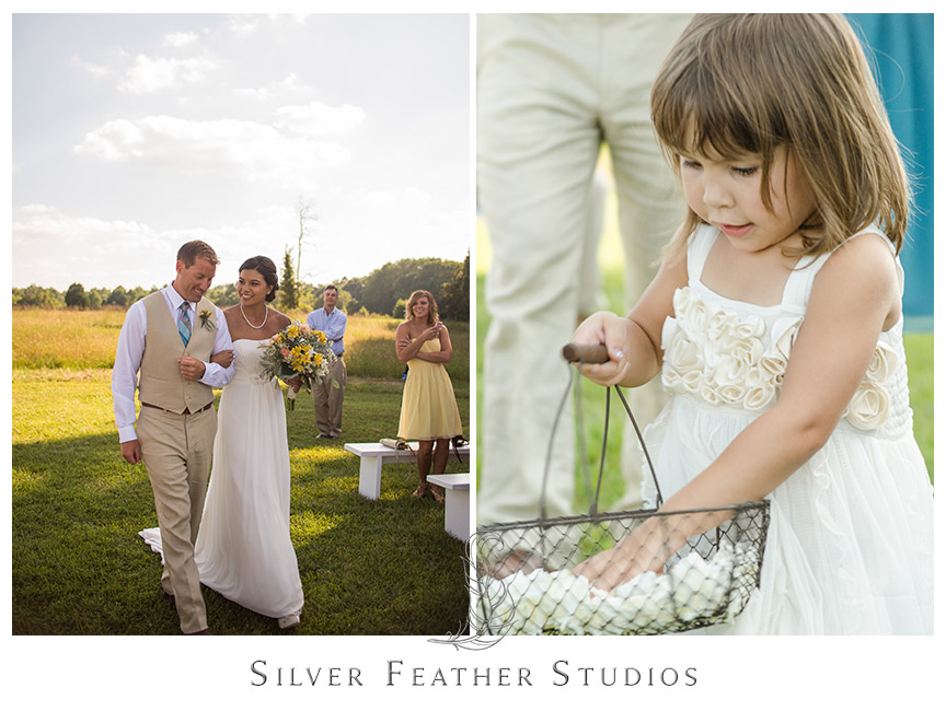 Groom escorts his bride down the aisle at Starlight Meadow.  © Silver Feather Studios, Burlington, NC Wedding Photography