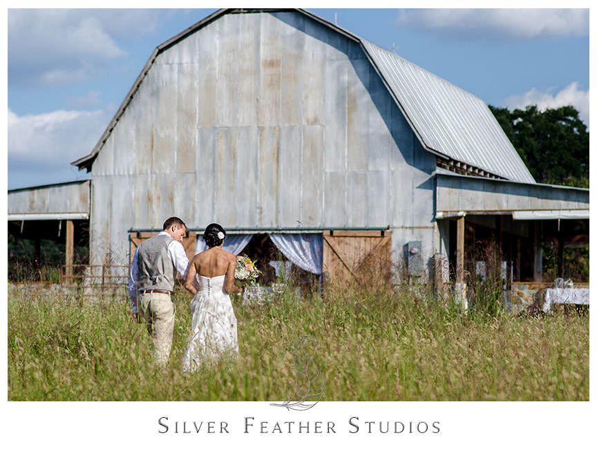 Beautiful barn makes a stunning backdrop for this outdoor Starlight Meadow wedding.  © Silver Feather Studios, Burlington, NC Wedding Photography