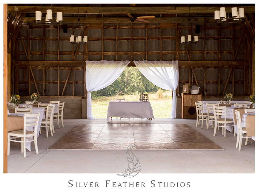 Burlap table runners and wooden beams make a beautiful rustic barn theme for this pink and aqua wedding.   © Silver Feather Studios, Burlington, NC Wedding Photography